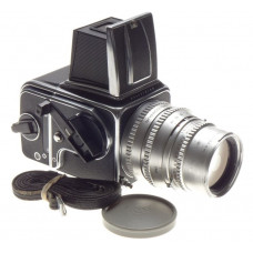 Prime chrome Sonnar 4/150mm Hasselblad lens and 500 C camera body cap and strap